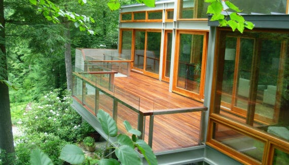 Stained IPE Deck with glass Railings in Pound Ridge, NY