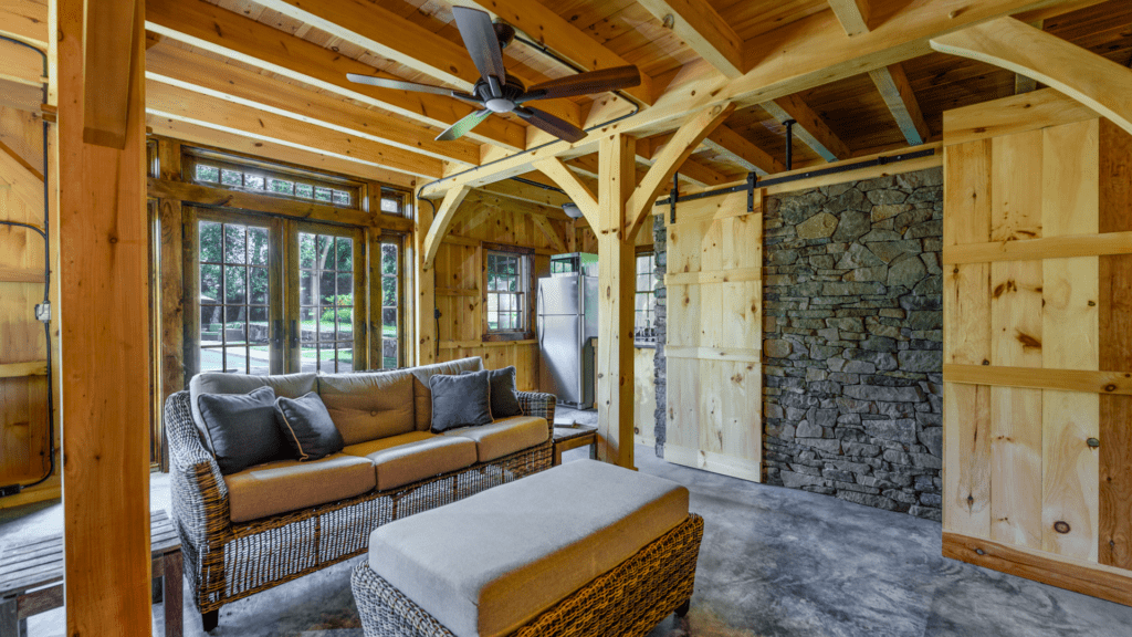 post beam style timber frame pool house northern white pine ashlar stone barn door hardware cement slab floor radiant heat katonah westchester