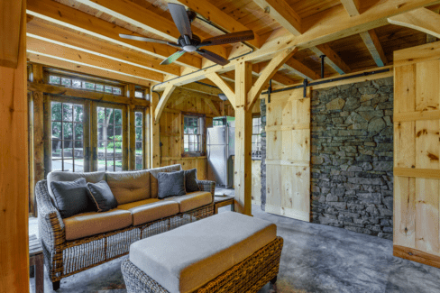 post beam style timber frame pool house northern white pine ashlar stone barn door hardware cement slab floor radiant heat katonah westchester