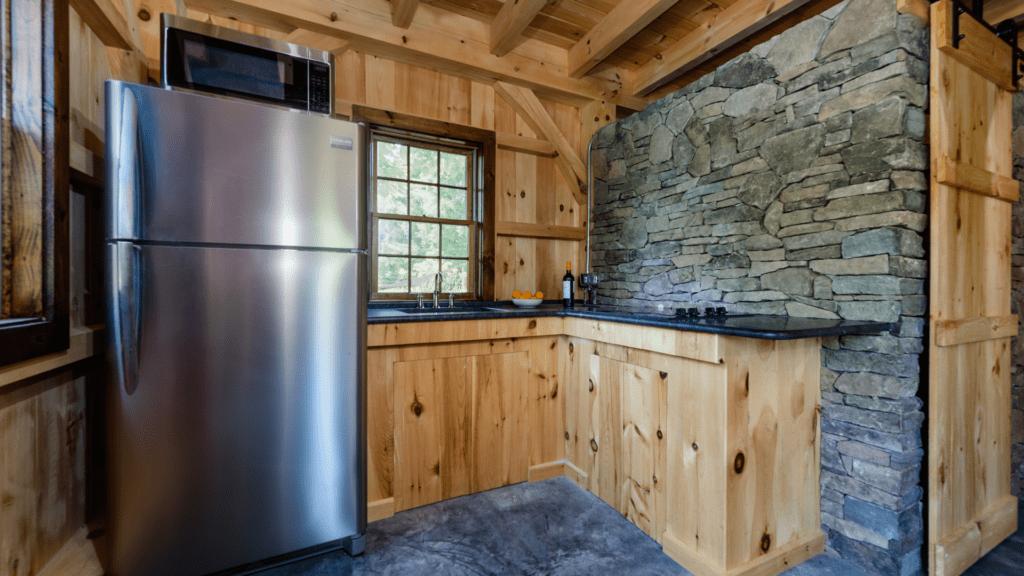 post beam style timber frame pool house northern white pine ashlar stone barn door hardware cement slab floor radiant heat kitchen honed granite counter katonah westchester