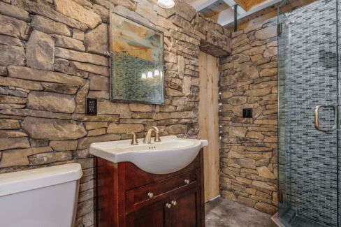 luxury bathroom timber frame pool house ashlar stone glass tile rain shower radiant heat cement slab floor katonah westchester