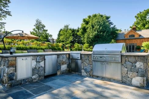 timber frame pool house outdoor kitchen bluestone patio faced fieldstone counter Lynx appliances katonah westchester