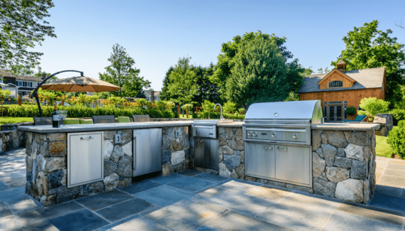 timber frame pool house outdoor kitchen bluestone patio faced fieldstone counter Lynx appliances katonah westchester