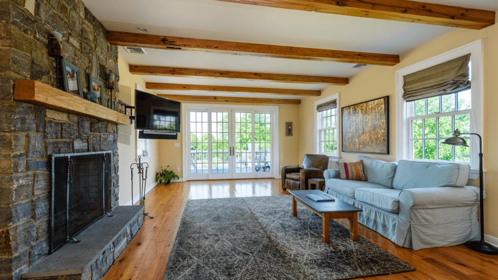 great room interior reclaimed oak beams flooring shelving adirondack ashlar stone fireplace katonah westchester