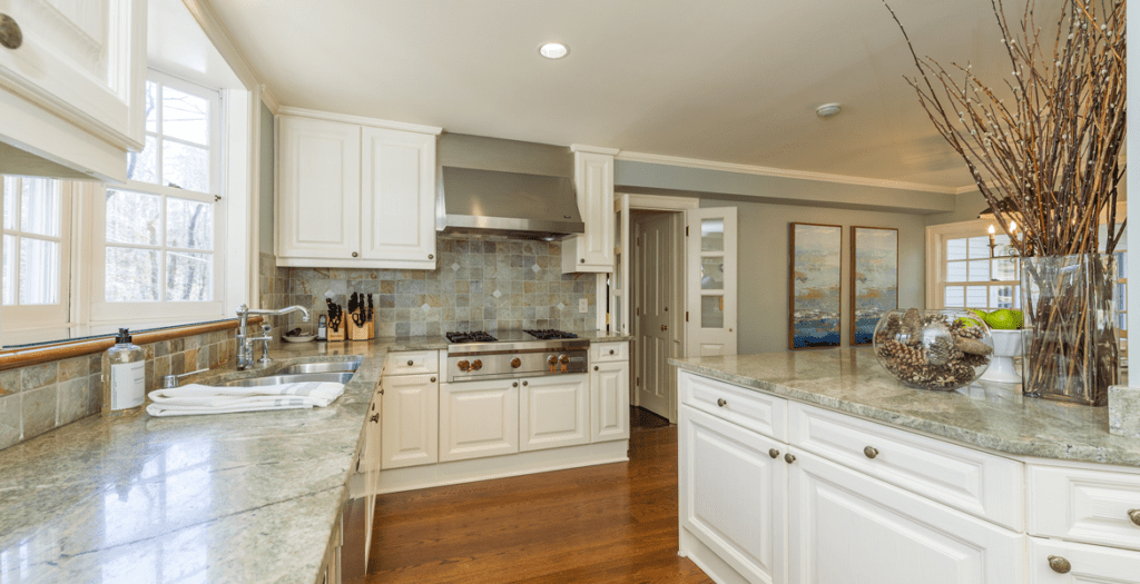 Modern-country-kitchen-with-Granite-countertop-complimenting-the-tile-backsplash--in-North-Salem,-NY-